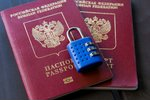Two russian passports locked to ...