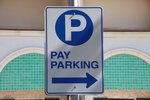 Pay parking blue and white sign ...