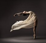 Ballerina dancing with silk...