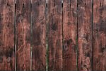 Brown  wooden board fence. dark ...