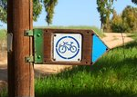 Wooden signpost with a bicycle...