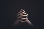 Praying hands with faith in...